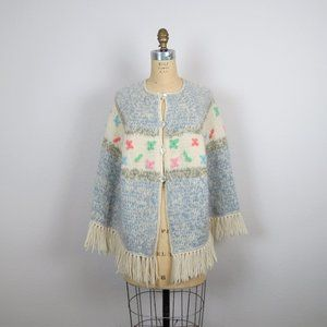Vintage 1970s hand knit poncho, pastel floral
